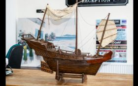 Model Boat of A Pirate Ship made out of wood and on a plinth. Chinese engravings to the rear.