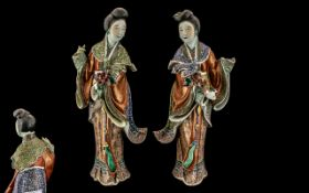 Pair of Chinese Antique Famile Rose Figures of Maidens Holding Lotus Blossoms,