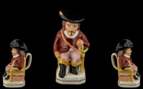 Antique Staffordshire Jug In The Shape of a Cavalier Wearing a Flam Buoyant Black Hat with a