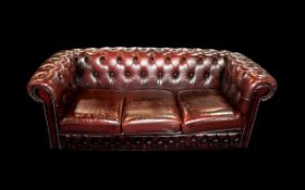 An Ox Blood Leather Chesterfield Sofa. W