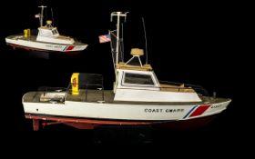 Model Lifeboat coast guard ship on plint