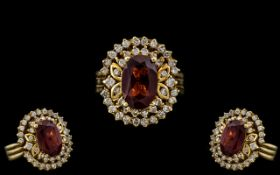 18ct Gold - Attractive and Heavy Ruby and Diamond Set Cluster Ring - Flower head Design.