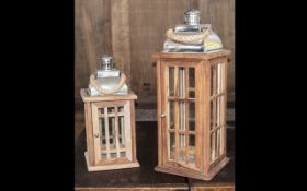 A Pair of Reproduction Teak Storm Lanterns with Lattice front cemented with metal tin canopy top.
