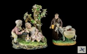 Sampson Copy of a Meissen Figure Group of a boy and girl on a mossy bank, with a picnic hamper,