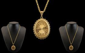 Attractive 9ct Gold Oval Shaped Hinged Locket with Diamond Cut Star burst Design to Front Cover,