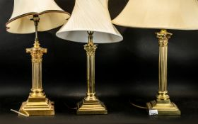 Two Mid 20thC Gilt Brass Corinthian Column Table Lamps. Of good quality. Together with one other.