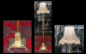 Brass Corinthian Column Standard Lamp with extension on a square step base terminating in poor feet