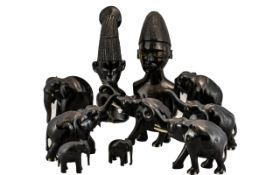 Collection Of Eight African Carved Elephants Together With Two Carved Figures.