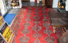 Extra Large Turkey Red Wool Carpet of traditional design. Approx.