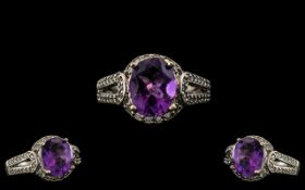 Ladies - Attractive 9ct White Gold Amethyst and Diamond Set Dress Ring. The Central Faceted Amethyst