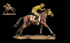 Painted Resin Figure of a Jockey Riding Horse Number Two,