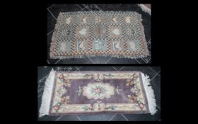 "Two Small Rugs, one beige wool with cream floral relief and fringing, measuring 24"" x 56"" approx,"