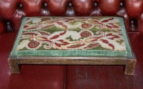 Tapestry Top Low Foot Stool raised on four square legs, with dark green and red tapestry top.