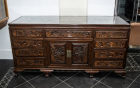 A Large And Impressive Chinese Carved Hardwood Sideboard, With A Cupboard Centre Between Nine