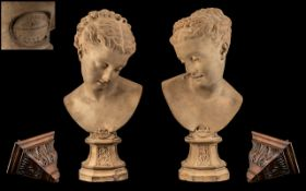 A Pair of Victorian Portrait Fired Clay Busts of Young Women Mounted on a pedestal base,