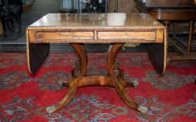 A Fine Quality Regency Rosewood Sofa Table of larger than average size,