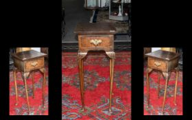 A Queen Anne Style Small Walnut Telephone Table with a centre drawer of Queen Anne shaped legs.
