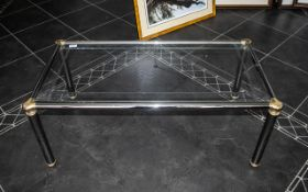 Glass Top Coffee Table with brass and chrome base, measures approx.
