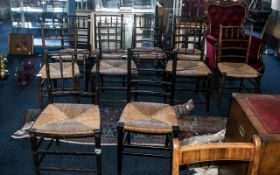 A Harlequin Set of 10 William Morris Suffolk Style Rush Seated Country Chairs, in stained beech.