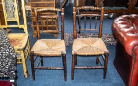 A Pair of Antique Rush Seated Elm Spindle Back Country Chairs. On tapering round legs, circa 1800s.