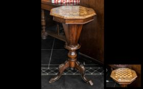 Victorian Walnut Worktable, octagonal top with chessboard, various inlay to the hinged top, which