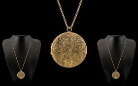 A Large and Impressive 9ct Gold Circular Hinged Locket with Engraved Decoration to Front Cover,