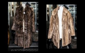 Honey Coloured Mink Jacket with collar and reveres, two side pockets, fully lined in sateen fabric