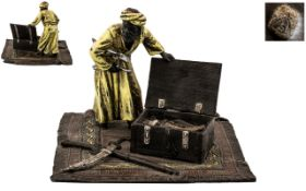 Modern Bronze In The Style Of Bergman a middle Eastern man selling his weapons out of a hinged trunk