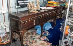 Queen Anne Period Low Dresser with brass drop handles and three drawers. Later replaced legs in need