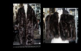 Dark Brown Fur Coat with collar and reveres, two slit pockets, fully lined in patterned sateen, hook
