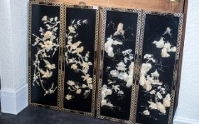 Set of Four Black Lacquered Chinese Wall Panels depicting flowers and birds; 36 inches (90cms) x