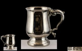 Elizabeth II - Superb Sterling Silver Tankard with Plain Body and Ornate Scroll Handle In