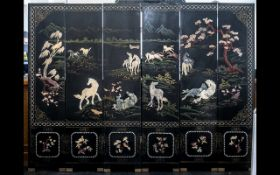 A Six Panel Chinese Lacquered and Harstone Applied Screen depicting wild horses in landscape with