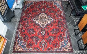 A Genuine Excellent Quality Persian Sarouk Carpet/Rug decorated in a traditional floral design on