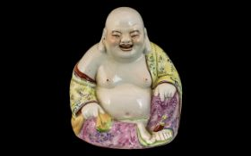 Small Chinese Republic Famille Rose Decorated Buddah Figure, sitting and smiling. Impressed marks to