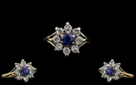Ladies - Attractive 18ct Gold Diamond and Sapphire Set Cluster Ring - Flower head Setting. The