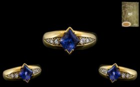 18ct Yellow Gold - Attractive Sapphire and Diamond Set Dress Ring. The Central Cornflower Blue