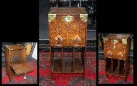 Arts & Crafts Pokerwork Cabinet, with pull down front above sectional base, brass strapwork