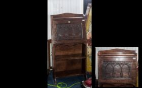 An Arts & Crafts Carved Front Bureau with a Fitted Interior, and open book shelf below, of small