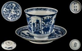 Antique Chinese Blue and White Decorated Tea Cup and Saucer, Depicting Flowers In Shaped Panels,