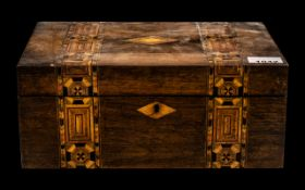 A Victorian Walnut Inlaid Ladies Sewing Box, with a fitted interior, measures 12'' wide x 5'' high.