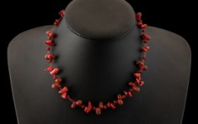 Early 20th Century Red Coral Necklace of Pebble and Natural Form. 16 Inches In length. Please See