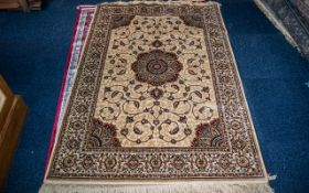 A Cashmere Gold Ground Unique Medallion Design Rug measuring 1.70 by 1.20 m. As new condition.