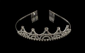 White Austrian Crystal and Faux Diamond Tiara, a classic design of arches and loops encrusted with