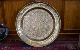 Large Antque Oriental Embossed Brass Dish with a floral design, 36 inches (90cms) in diameter