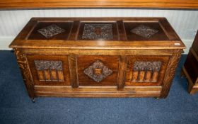 Reproduction Carved Oak Mule Chest with a Three Paneled Lift up Lid and Parcels to the Front..