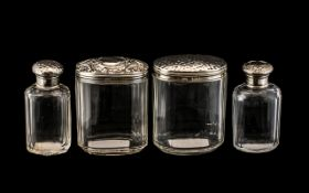 Collection of Silver Topped Dressing Table Bottles, four antique silver topped jars and bottles, 3.