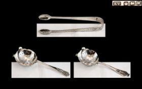 George VI - Pair of Sterling Silver Ornate Tea Strainers by Viner.