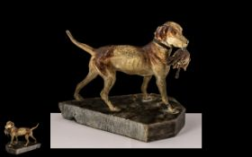 A Cold Painted Metal Figure of a Hound Dog with Rabbit in Mouth, fixed on a marble base,