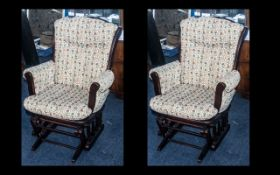 A Pair of Upholstered Stained Mahogany Cottage Rocking Chairs made by Dutailier,